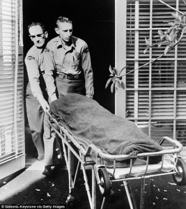 Marilyn's body being taken out of her home.