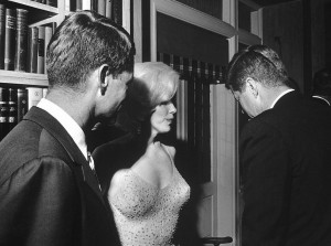 Marilyn Monroe with the Kennedy brothers.
