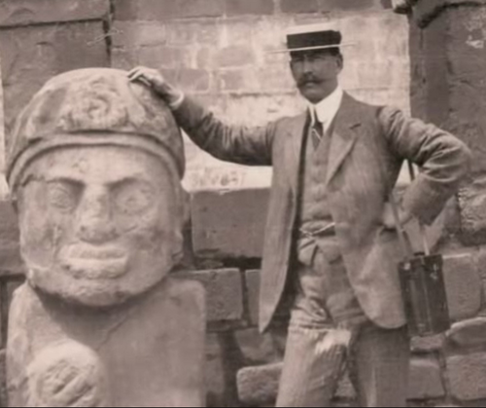 Percy Fawcett with an Olmec (?) statue.