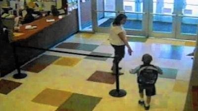Surveillance footage of Amy and Timmothy leaving his school. (Image credit here.)
