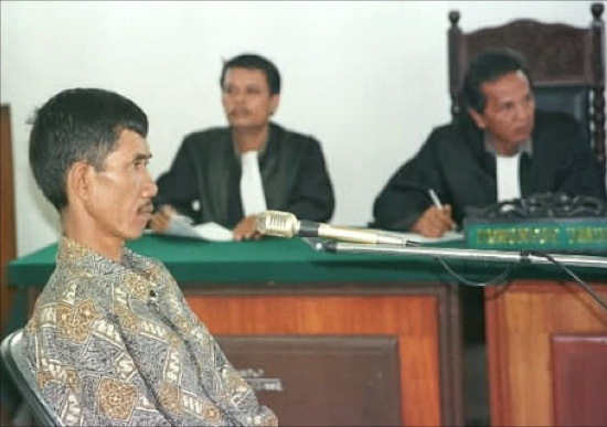 Ahmad Suradji on trial. (Image source/credit here.)