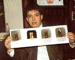 Angel Gordon displaying pictures of the Gnome of Gerona remains. (Image credit/source here.)